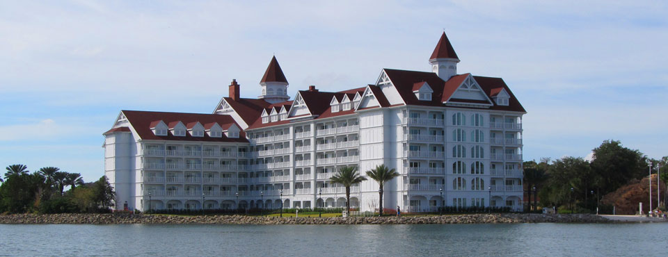 View of a large building for accommodations at the Disney Grand Floridian from the lake on a boat wide