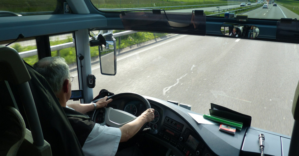 Bus Driver on the road taking guests to Disney World