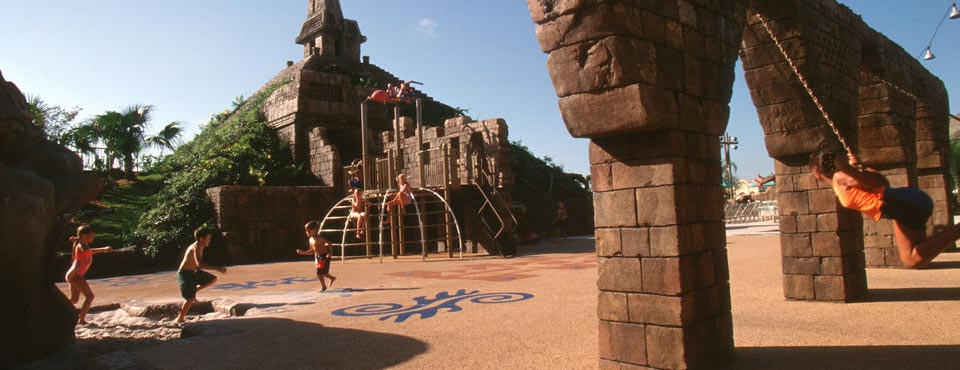 Kids playing at the dig site at the Disney Coronado Springs Resort in Orlando with Playground and Water Fountains 960