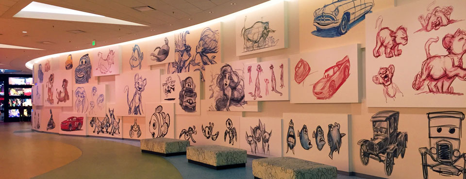 Disney Art of Animation Resort in Orlando interior walls in the lobby full of disney character drawn images 960