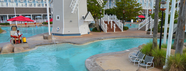 Disney Beach Club and Yacht Club Stormalong Bay Lazy River entrance with Lifeguard looking on wide