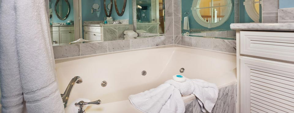 View of a large, relaxing Jacuzzi Tub in the Master Suite at the Garden Cottage at Disney's Boardwalk Inn Resort