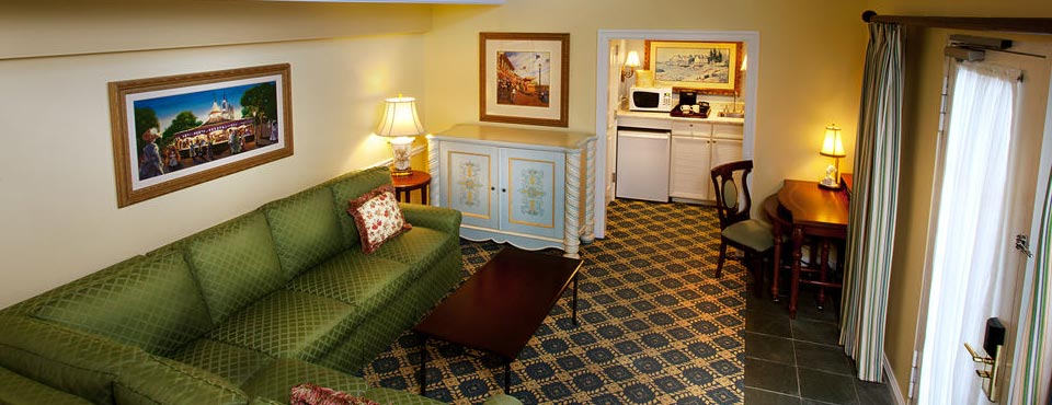 View of the large sectional sofa in the Living Room space in the Garden Cottage at Disney's Boardwalk Inn Resort