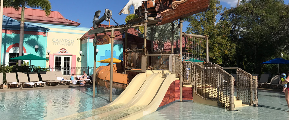 View of the Shipwreck Kids Splash Park with toddler water slides and interactive fun at the Disney Caribbean Beach Resort 960
