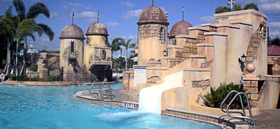 Water slide built into an outer town wall at the Disney Caribbean Resort