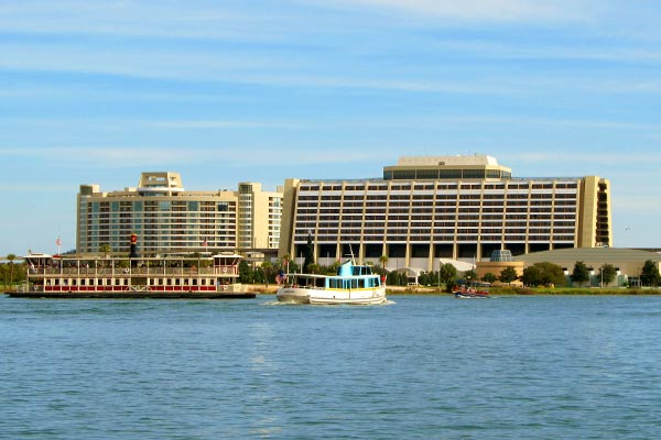 View of the Disney Contemporary Resort from the Seven Seas Lake with boats in front of the main building 600