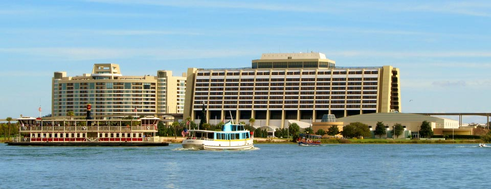 View of the Disney Contemporary Resort from the Seven Seas Lake with boats in front of the main building 960