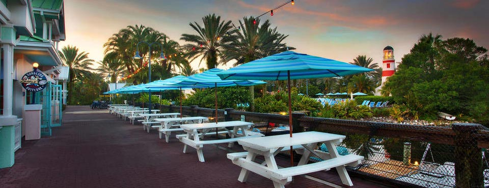 View of a row of Picnic Tables overlooking the pools at the Disney Old Key West Resort in Orlando 960