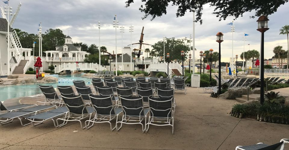 Lounge Chairs stationed around the pool at Stormalong Bay Disney Yacht Club