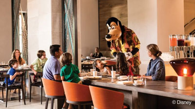 Goofy at a family table entertaining and talking to the kids at the Four Seasons Orlando Character Breakfast