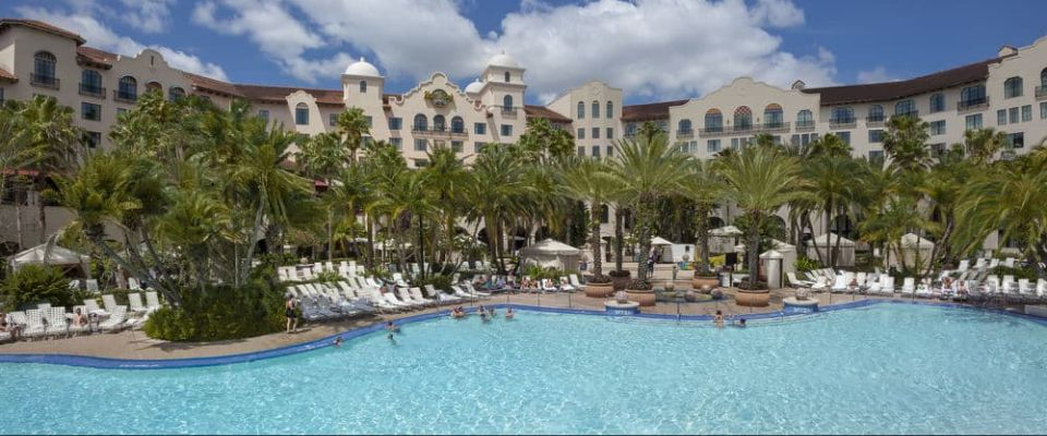 A beautiful view of the massive Hard Rock Orlando Hotel Pool with lounge chairs all around 960