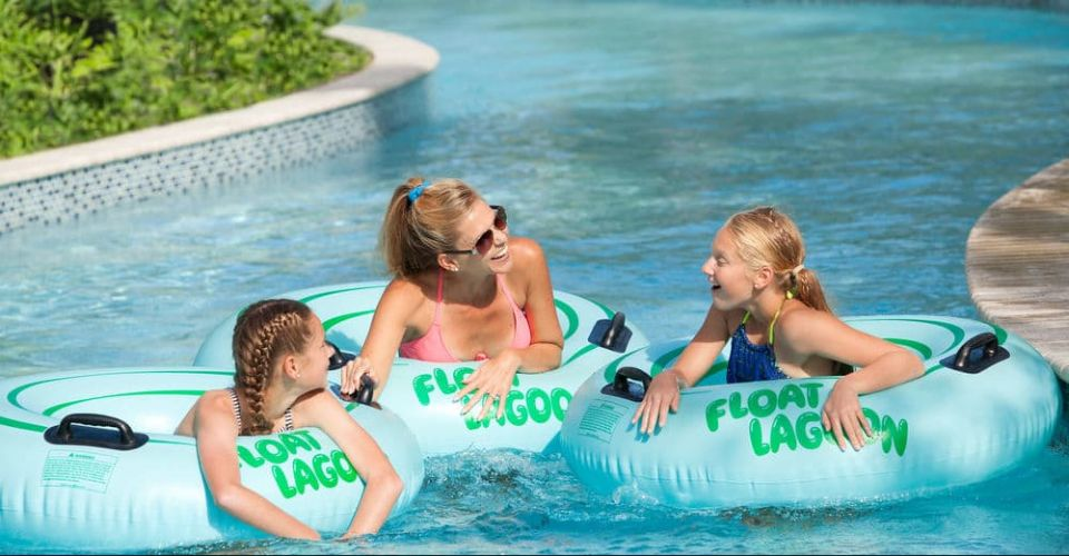 Family fun on tubes floating on the Lazy River Hilton Buena Vista Palace