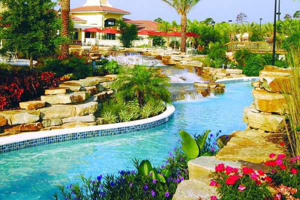 View of a section of the 1,200 foot Lazy River with Rock Water Fall at the Holiday Inn Orange Lake Resort in Orlando Fl 600