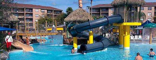 View of the Enclosed Water Slide at the Liki Tiki Village Lagoon Pool 650w