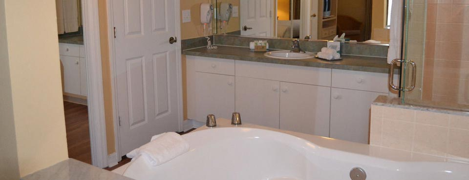 Master Bathroom with large Jacuzzi Tub at the Liki Tiki Resort in Winter Garden Florida