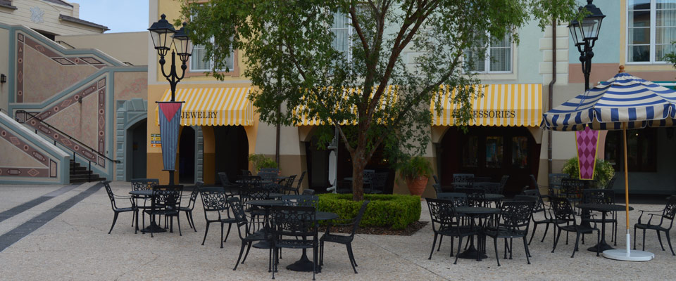 Outdoor seating with quaint tables and chairs at the Loews Portofino Bay Resort at Universal Orlando