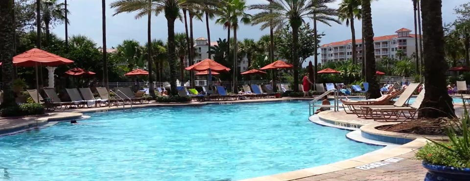 View of an Outdoor Heated Pool with Seating and Umbrellas at the Grande Vista Marriott Resort in Orlando Fl 960