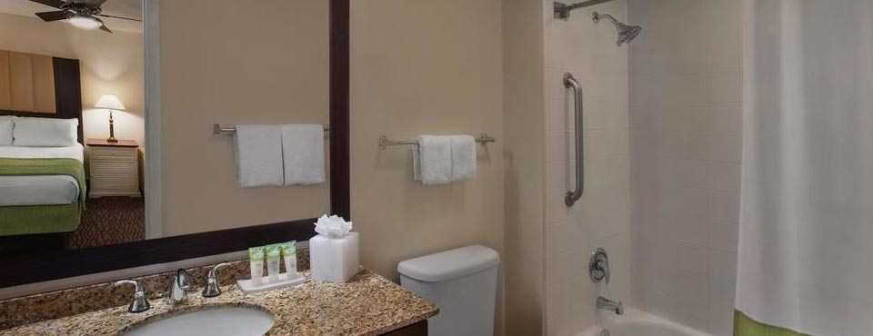 The Bathroom is spacious with a granite counter sink and tub shower unit at the Marriott Harbour Lake in Orlando
