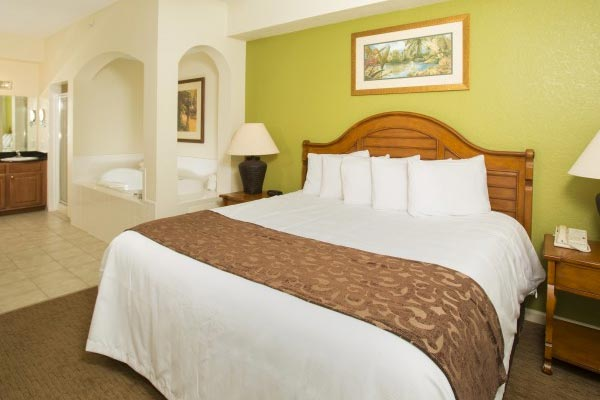 View of the Master Bedroom with in-room Jacuzzi Tub at the Lake Buena Vista Village Resort and Spa in Orlando Fl