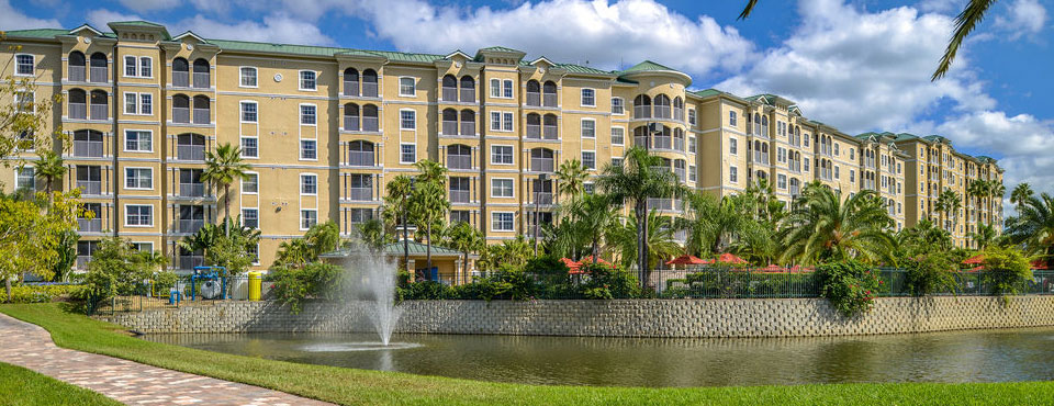 One of the large 6 story buildings that make up the Mystic Dunes Resort Villas overlooking the lake wide