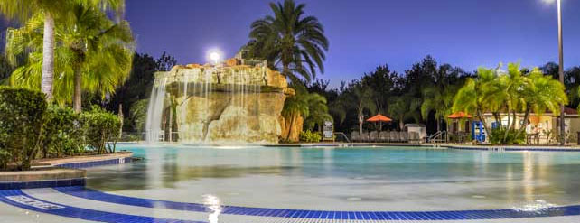 Easy access to the entry of the Dunes Lagoon heated pool with gentle sloping at the Mystic Dunes Resort in Orlando