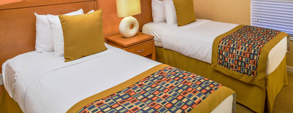 bedroom with 2 twin beds at the orbit one vacation villas in orlando