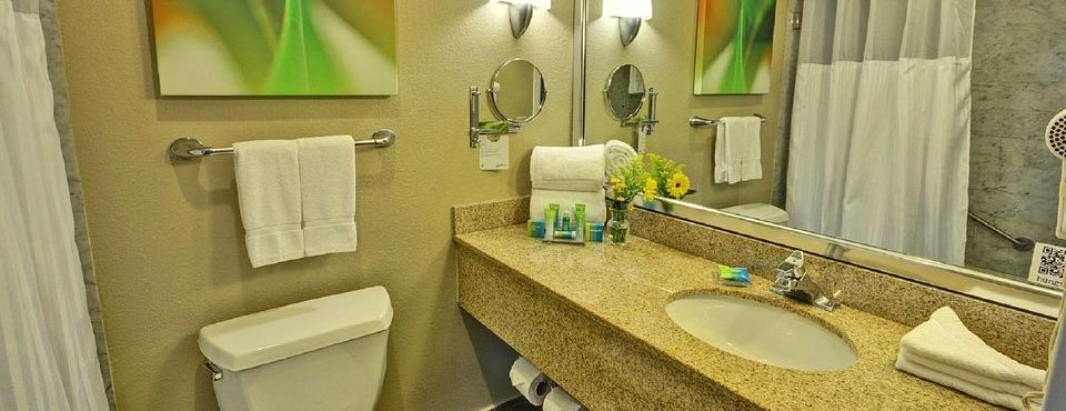 Bathrooms come with granite top sink and tub / shower unit at the Radisson Resort Orlando Celebration