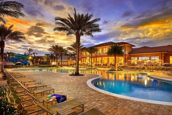 View of a beautiful evening by the pool at the Regal Oaks Resort CLC in Kissimmee Fl 600