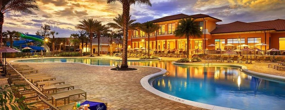 View of a beautiful evening by the pool at the Regal Oaks Resort CLC in Kissimmee Fl 960