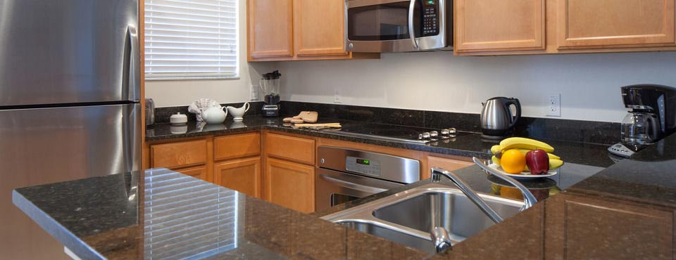 Full size kitchen in a 3 bedroom townhouse at the Regal Oaks Resort CLC in Kissimmee Fl