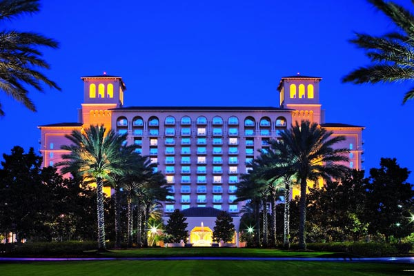 View of the Front Entrance to the Ritz-Carlton Grande Lakes in Orlando lit up in the evening 600