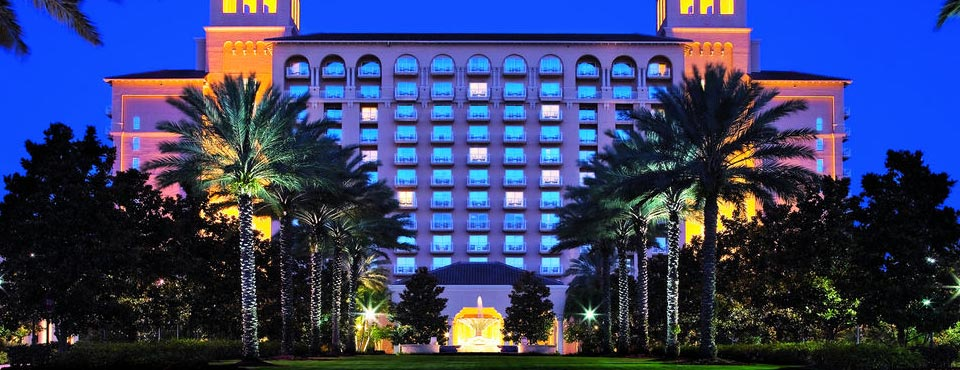 View of the Front Entrance to the Ritz-Carlton Grande Lakes in Orlando lit up in the evening 960