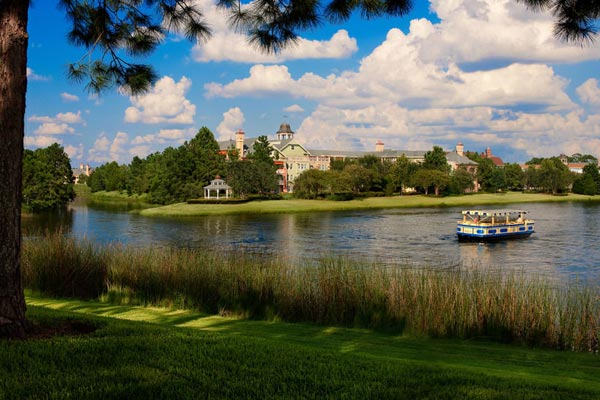 View of Disney Saratoga Springs across the water with water taxi in view 600