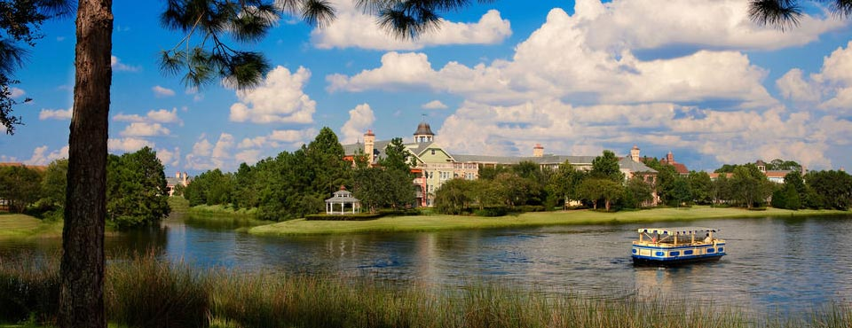 View of Disney Saratoga Springs across the water with water taxi in view 960