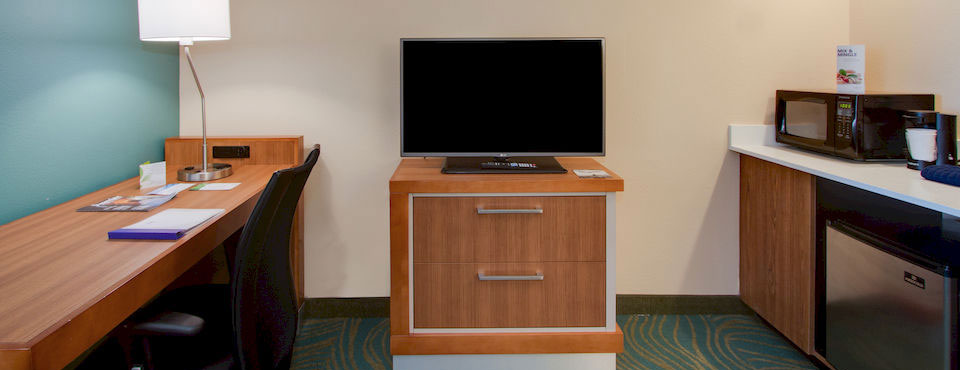 Mini-fridge and Microwave and desk in cubby at the Springhill Suites in Kissimmee Fl