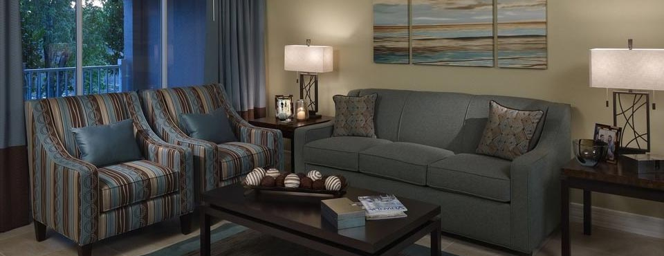 Big living room space with Sleeper Sofa and a couple of large, comfy chairs at the Summer Bay Resort Orlando