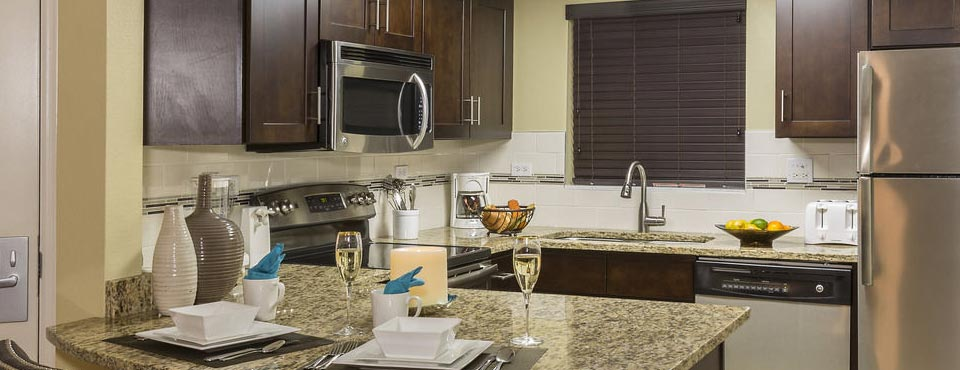 Condo with full size Kitchen, Refrigerator, Stove, Dishwasher and Microwave with Granite Counters at the Summer Bay Resort in Orlando Fl