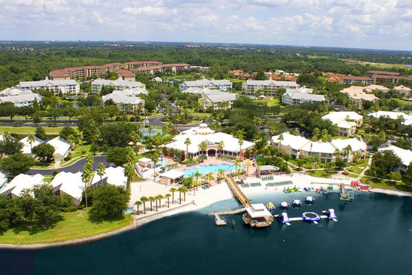 Overview of the Summer Bay Resort in Orlando Clermont Florida with Lake and Water Craft as well as a large outdoor heated pool 600