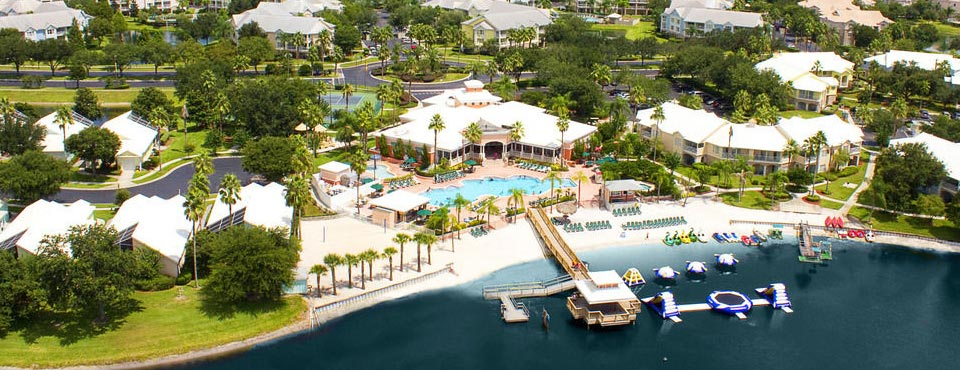 Overview of the Summer Bay Resort in Orlando Clermont Florida with Lake and Water Craft as well as a large outdoor heated pool 960
