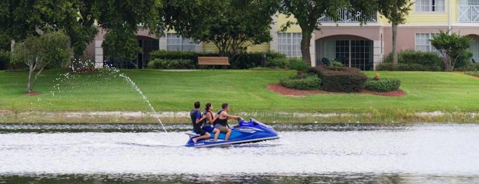 A Jet Ski with family floating on the Lake at the Summer Bay Resort in Orlando Fl