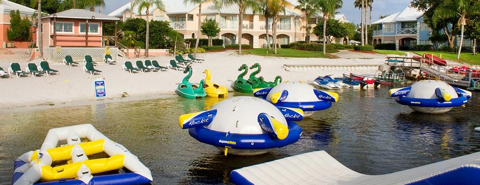 Summer Bay Resort in Orlando Lake with trampolines and slides