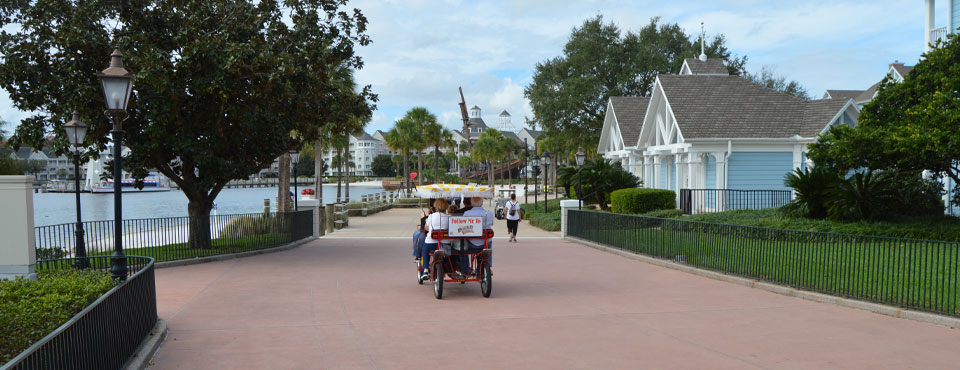 Taking a Surrey Bike around the Lake in front of the Disney Beach Club Resort in Orlando wide