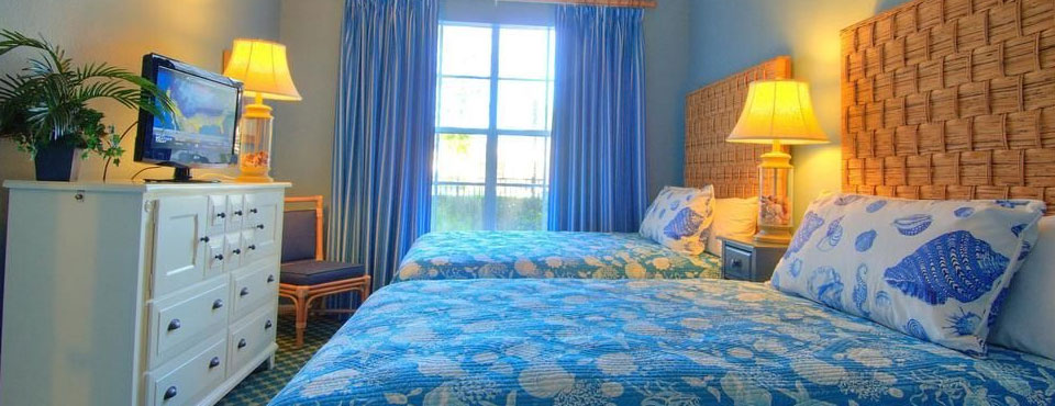 View of a Two Bedroom Villa 2nd Bedroom with Double Beds at the Calypso Cay Vacation Villas Resort in Kissimmee Fl