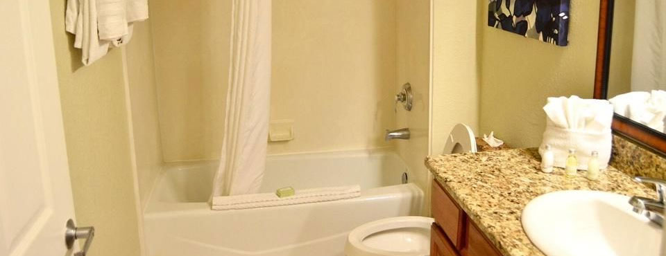 Villa Full Bathroom with single Sink and Tub and Shower Unit at the Calypso Cay Resort in Kissimmee Fl