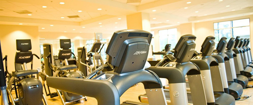 The Fitness Center view of a row of Treadmills at the Waldorf Astoria Orlando