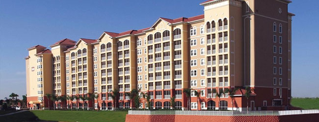 One of the large 6 story buildings that make up the Westgate Town Center Villas overlooking the lake