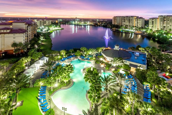 Wyndham Bonnet Creek in Orlando Fl view of pool in the evening overlooking the beauty of the lake 600