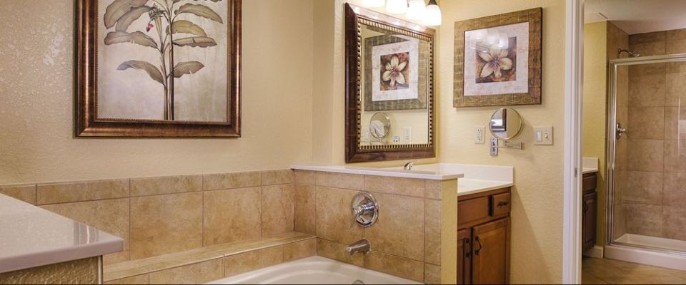 Elegant Bathrooms with solid tops, whirlpool tubs and even a stand up shower unit at the Orlando Wyndham Bonnet Creek Resort
