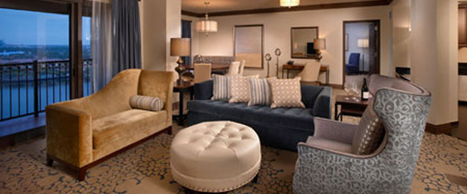 A very large living space with plenty of seating over the Dining Rooms at the Presidential Suite at the Wyndham Grand Orlando